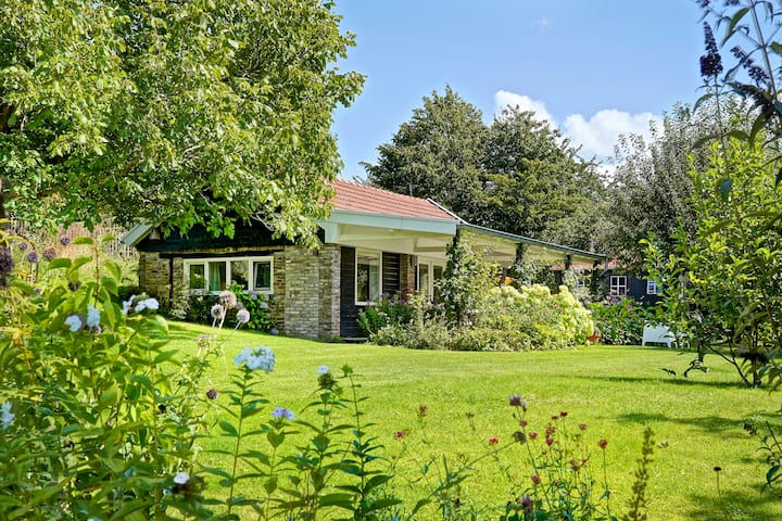Cottage with beautiful view in hilly countryside