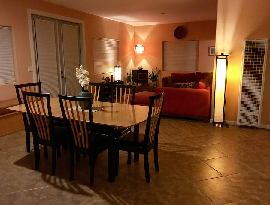 Dining room and living room with soft lighting for a relaxing evening.