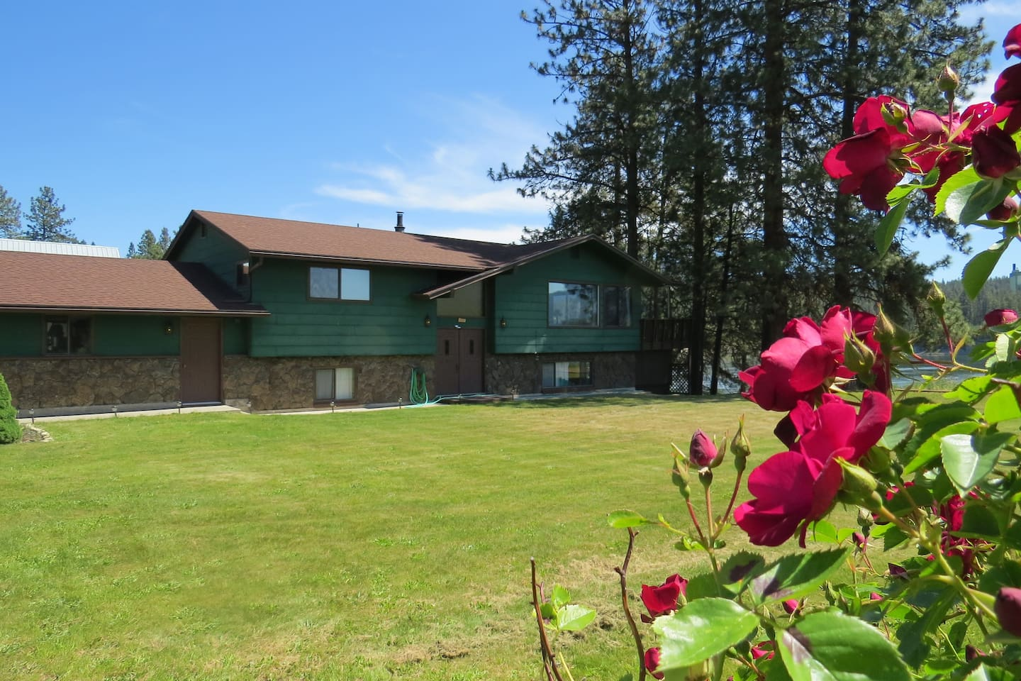 Riverwood Whole House Rental includes 4 bedrooms, 3 bathrooms, 2 kitchens, hi-speed WiFi, 3-4 person hot tub, upper and lower decks, a wide lawn, and spectacular views!