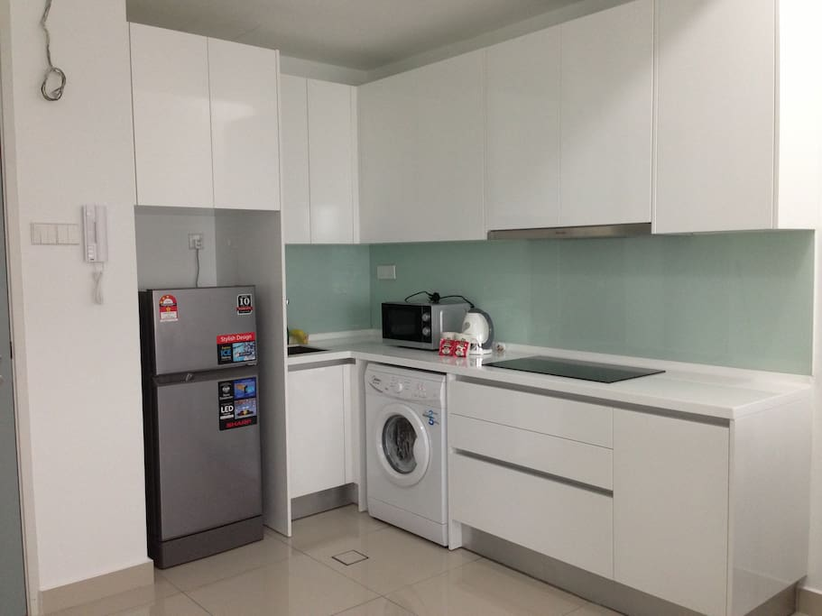 Kichen, fully equipped with refrigerator, microwave oven, kettle, cups, plates, bowls, light cooking utensils, forks and spoons. Washing machine is located in the kitchen and clothes dryer is in the small room.