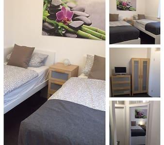 Zimmer Neubauwohnung im Hochpartere - Appartement