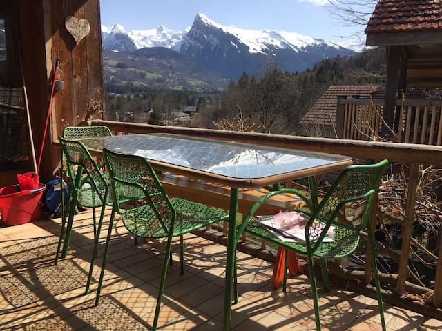 Sun terrace accessible from the kitchen with mountain views