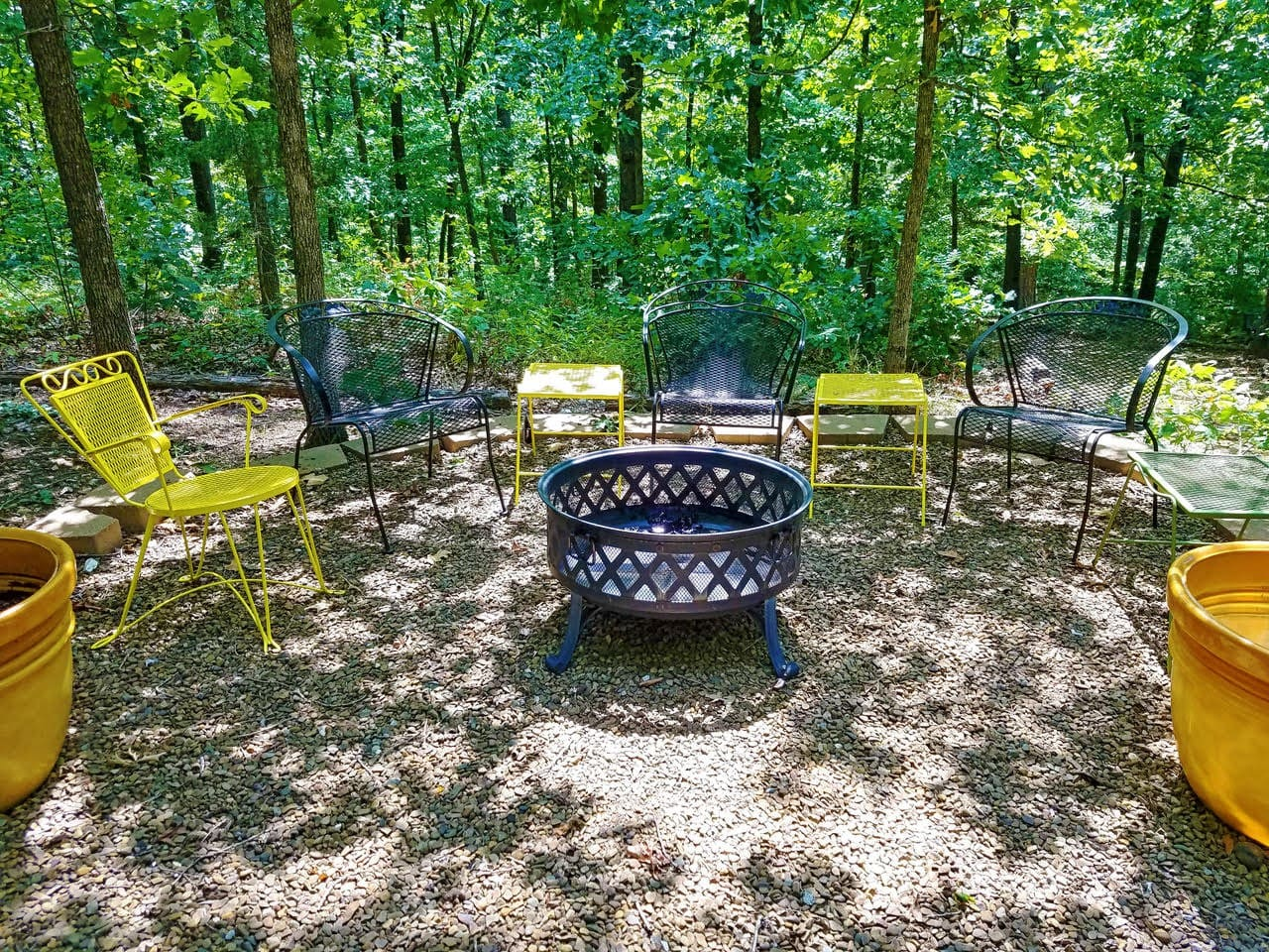 The Blue Door - is a spacious 1,000 sq ft apartment suite that overlooks a totally private and tranquil wooded setting. This is one of several seating areas in the woods and around the property.