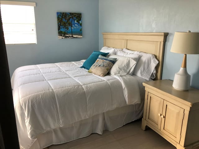 Master bedroom with all new comfy bedding and extra pillows! Rollaway bed in closet also.