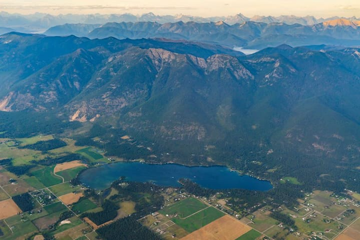 Aerial Photo of Swan Mountains & Lake Blaine; within walking distance from our guest suite. (**There is no public access to the lake, but its a nice walk to a great view)  Our place is just outside the photo in the lower left hand corner.