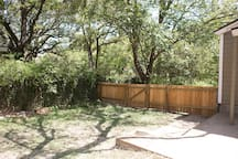 Fenced backyard. Bring your dogs!