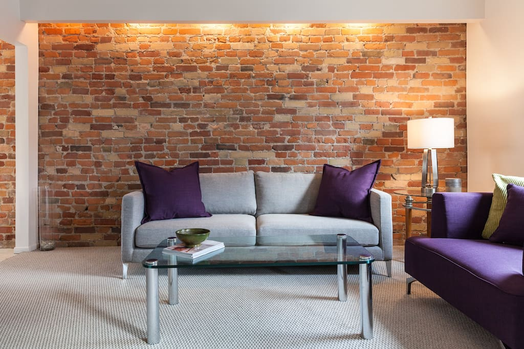 Exposed brick wall of living room.