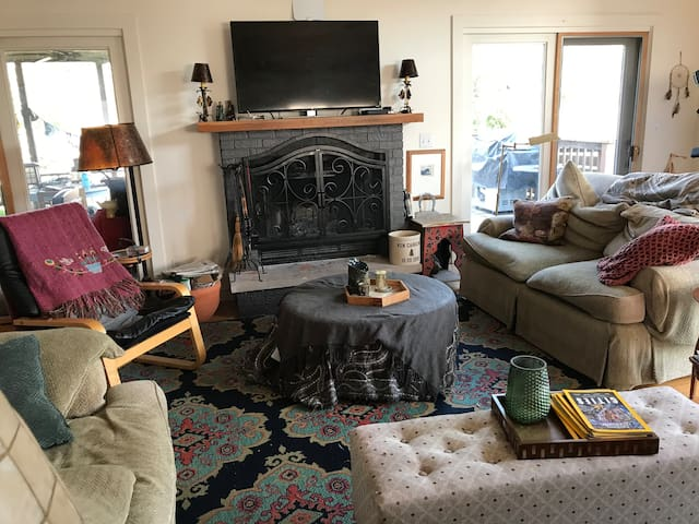 Main lvrm/great room with diningrm with real wood burning fireplace for cozy nights