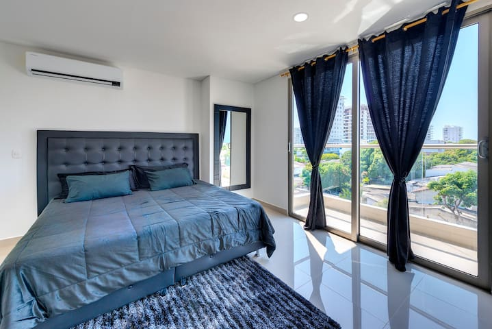 King Bed Suite #1 includes a balcony,  lockbox/ safe, DirectTV + Netflix