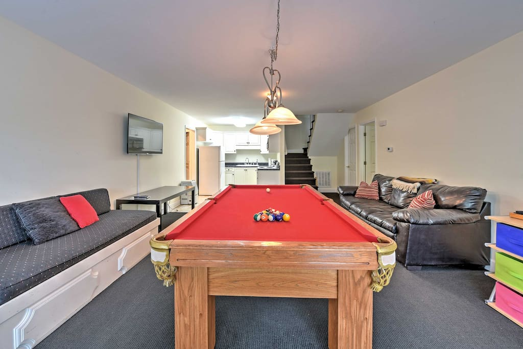 The home's lower level features a second living  area, complete with a full pool table and a 49-inch flat-screen TV!