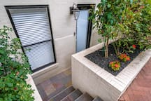 A beautiful rose garden greets you and your guests as you enter the apartment.