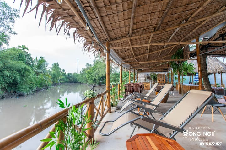 PEACEFUL RIVERSIDE PATIO HOMESTAY IN MEKONG DELTA