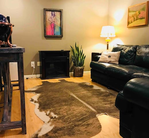 The living room provides a perfect space to relax, watch tv (we have DirecTV), or to catch up on some work. There is an electric fireplace for warmth and ambience and super comfy leather furniture.