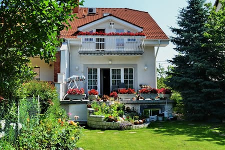 Budapest Airport, house with flower garden.Room C