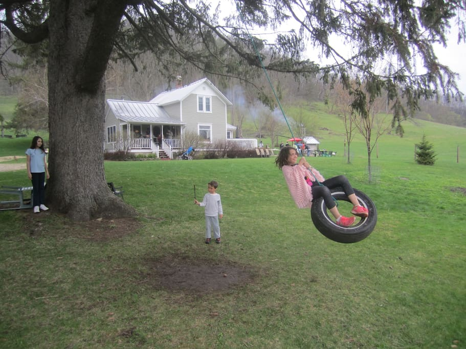 Kids love the large front lawn with its tire swing and fire pit for bonfires.