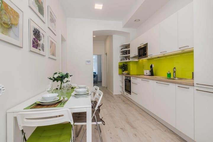 Welcome in our apartment. In the open common space there is kitchen corner, dining area.