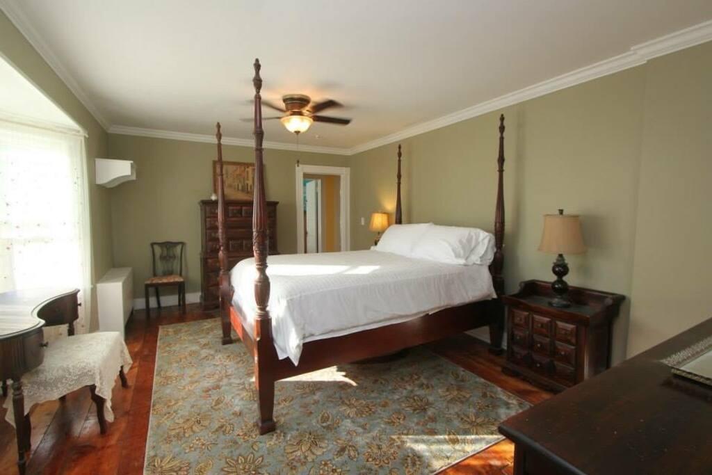 King sized bedroom with en suite bath
