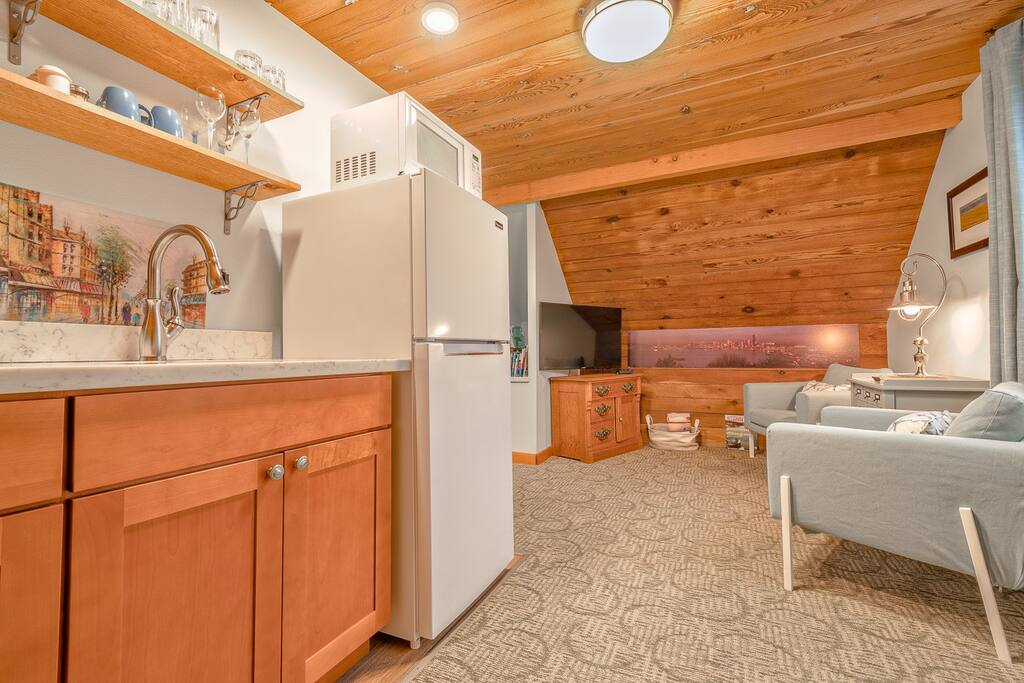Toaster, coffee maker, stainless sink, snacks, coffee, etc