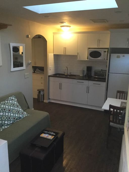 Main Living area.  Sitting room with attached kitchenette. Sofa bed converts to a small double bed. (Suitable for two children, 1 adult, or two smaller adults who like to cuddle...)