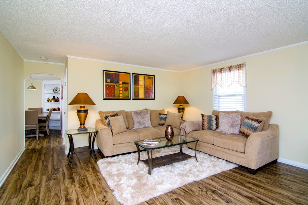 Warm and inviting living room, with a couch big enough for sleeping