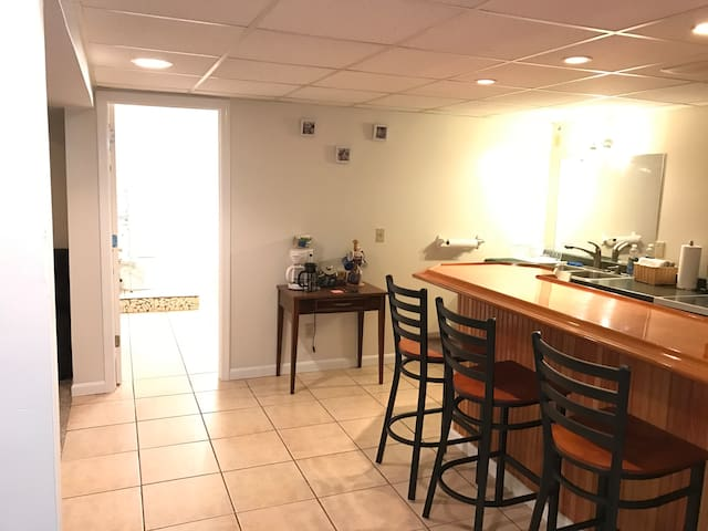 Kitchenette/bar to the right with door to huge full bath in front. Master bedroom open on the left.