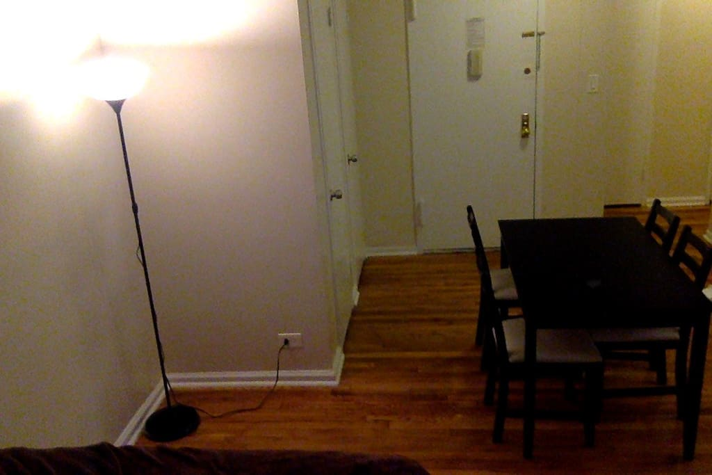 Entry door way and table with chairs