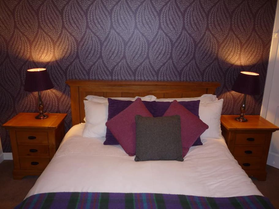 Comfortable king size bed with views over Loch Linnhe