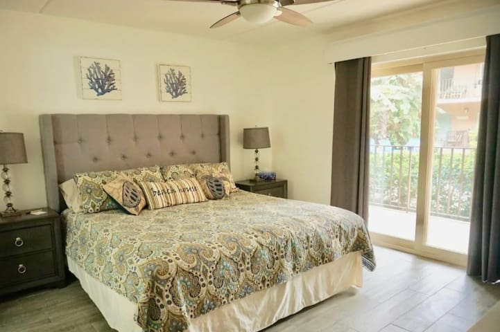Master Bedroom with pool view; access to porch