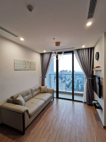 Living room has a large window welcome natural light in day time, a small balcony for you to enjoy the wind and sparkling building view at night. Wooden floor brings a cozy, elegant and classy style.