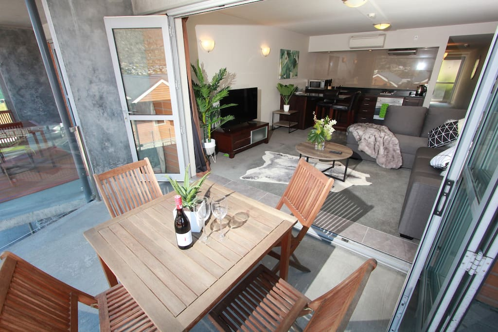 Bright and open living and kitchen area, located upstairs. Bi-fold doors from the lounge onto the balcony make for a great space.