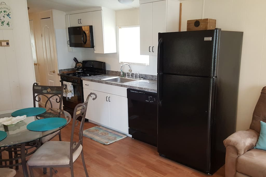 Newly remodeled kitchen with new cabinets, counter tops, sink and faucet and full size appliances.