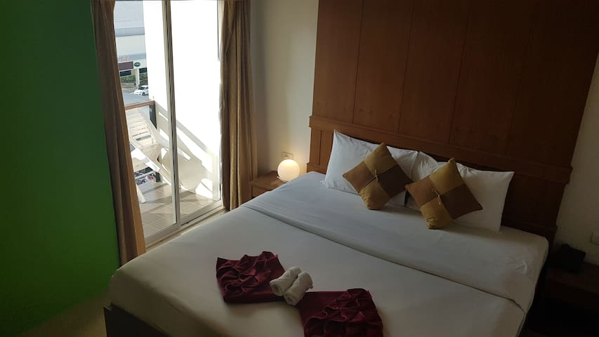 Rooms are located on the 2nd to 6th floors and features a private balcony with views of Patong City.  All Standard room has queen size beds or two single beds, air conditioning, a cable TV and minibar.