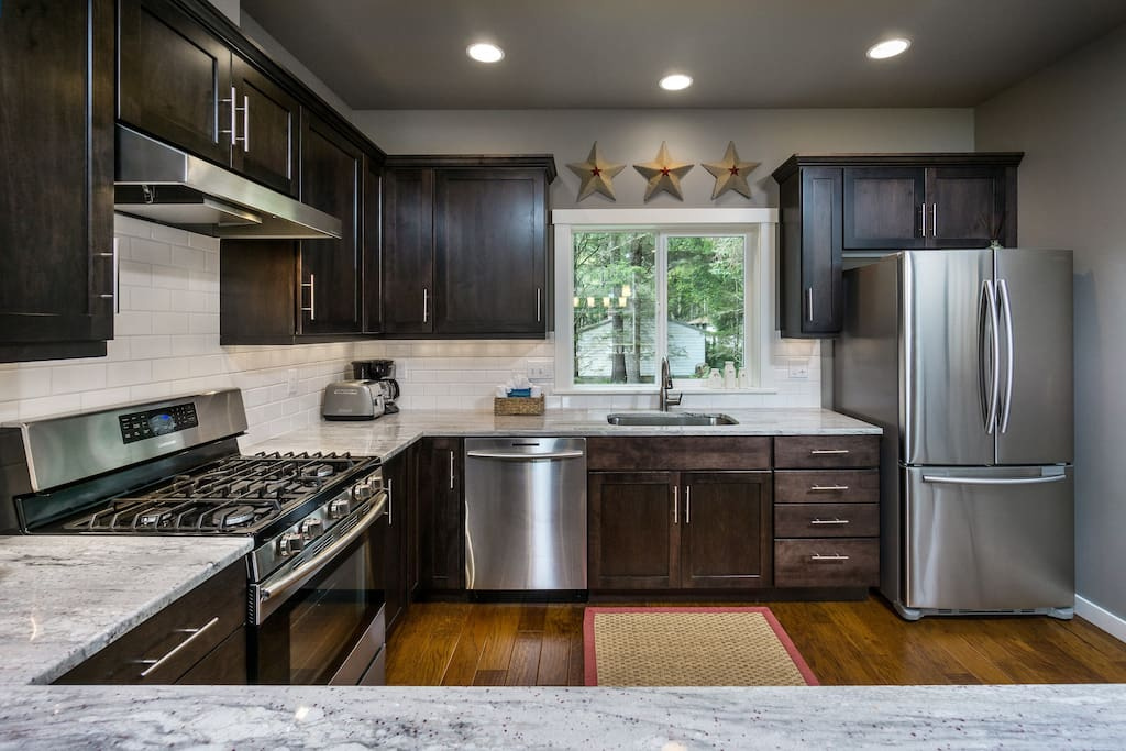 This brand new quality built home has a gorgeous well-stocked kitchen - bring your favorite recipes!