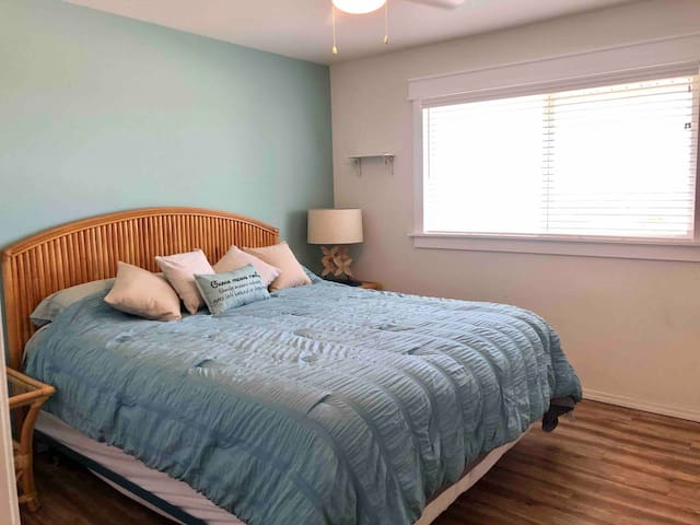 First bedroom with ocean view and king bed