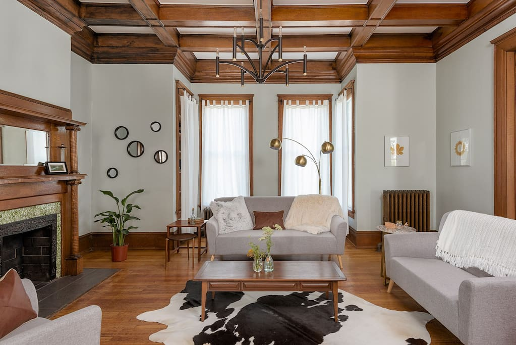 We love the calm of these rooms, big windows letting sunlight bring the oak trim to life.