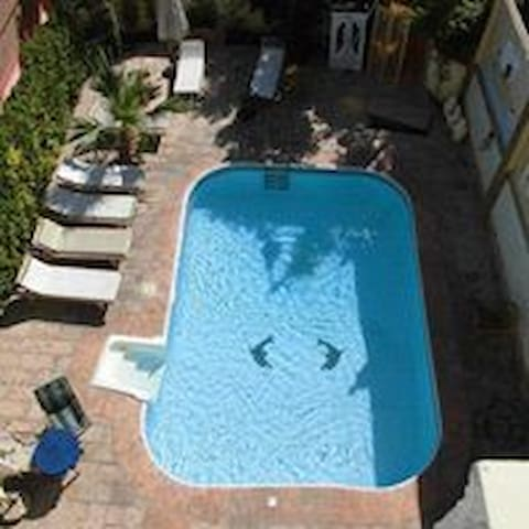 Swimming pool with sunbeds available