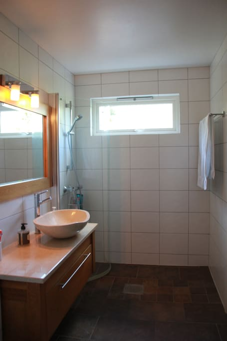 Modern and newly renovated bathroom that you will share with us.