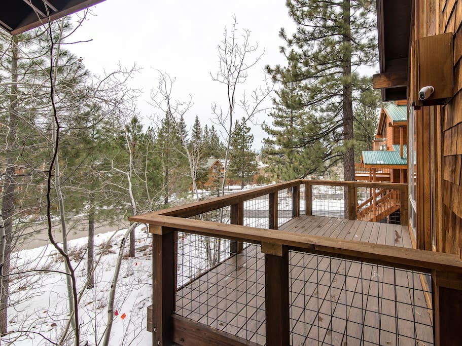 Enjoy pine-filled views from your private deck.