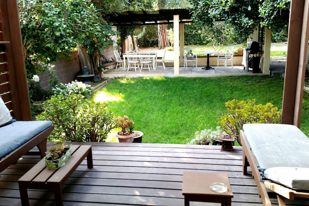 view of the large lush yard with patio