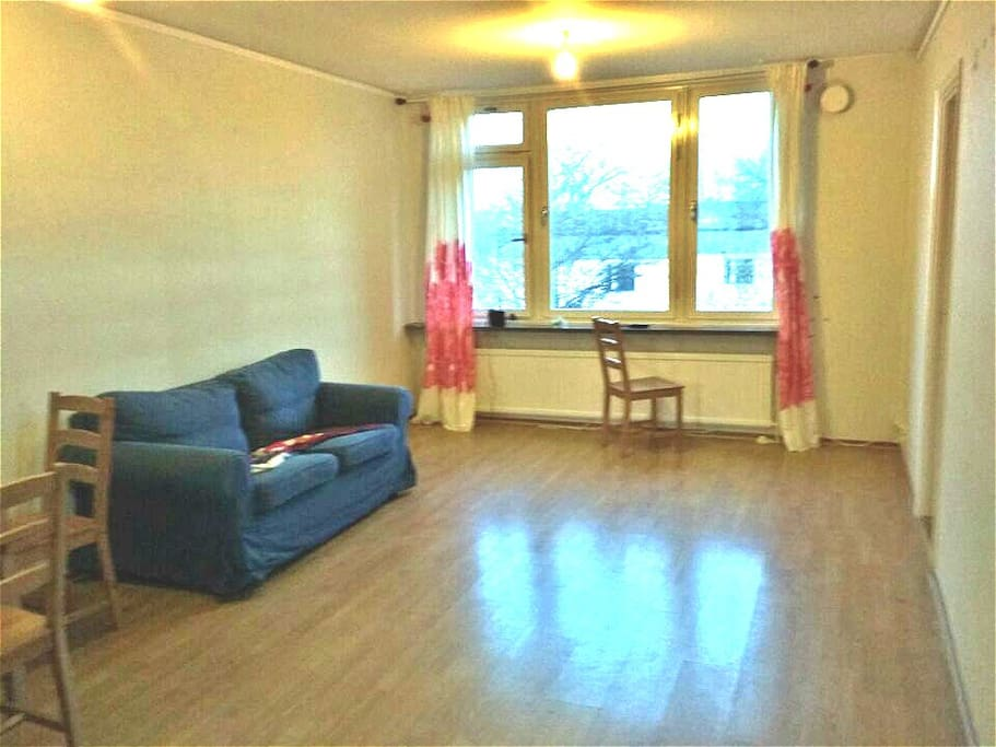 Very big living room with sofa, table and chair