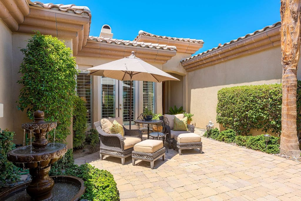 Entryway Courtyard with Luxury Seating and Fountain