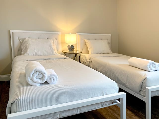 Our guest bedroom is perfect for the kids, or a couple of friends to share the room together. Two brand new, ultra modern and comfortable plush twin beds.