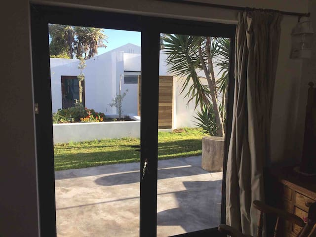 The protected outside space is great to hang out. There is an extra guestroom for 2 you can book for a cheaper rate.