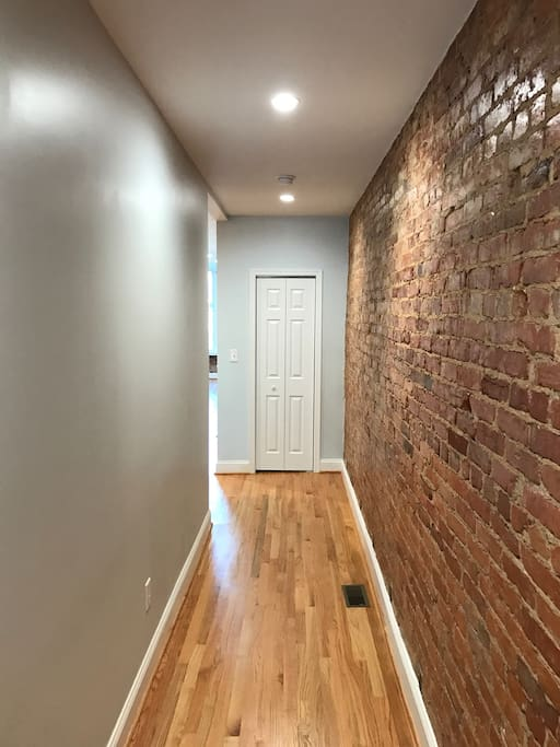 Exposed brick and hardwood floors throughout.