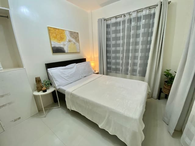 Guest room with double size bed and double size floor mattresses