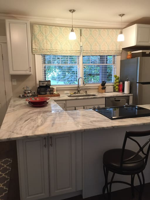 New kitchen! Complete with stove, dishwasher, refrigerator, microwave, coffee maker and toaster. Lots of pots and pans, crock pot and waffle maker.