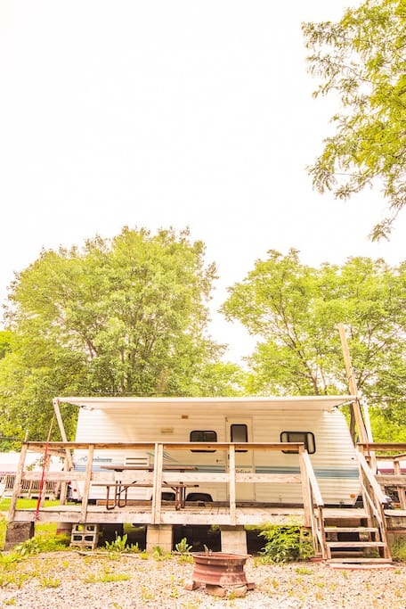 Travel Trailer with deck, picnic table and fire ring