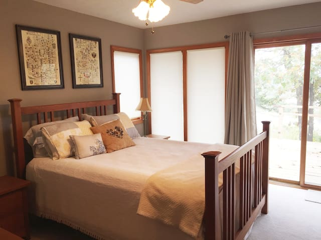 Master BR with queen bed has deck access and overlooks lake