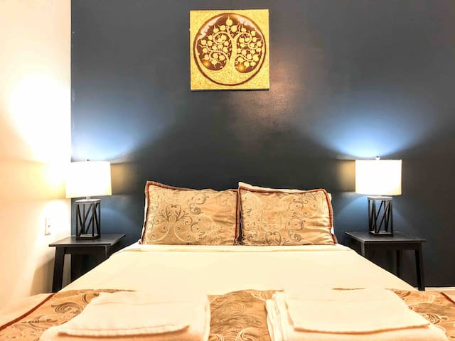 Spacious bedroom furnished with queen size memory foam bed for your comfort and a nice sleep. Plush, sanitized and fresh soft towels and welcome bottled water are provided
