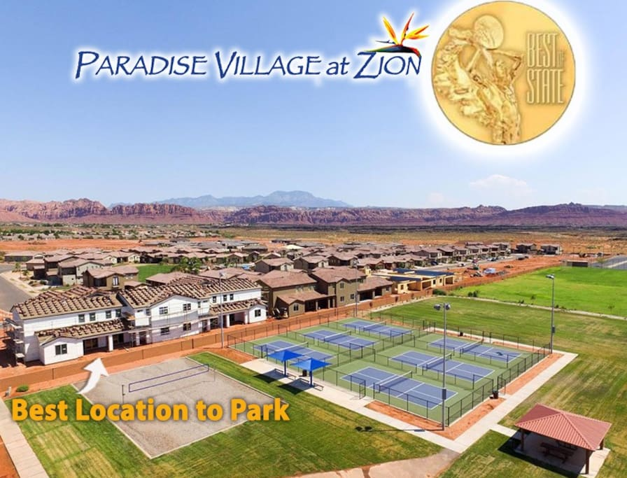Large luxury home overlooking pickleball courts with panoramic view of Snow Canyon